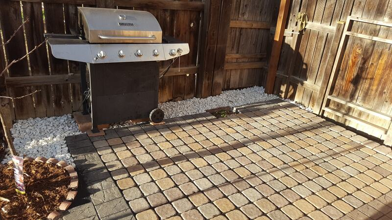 Cobbled patio in front of a grill