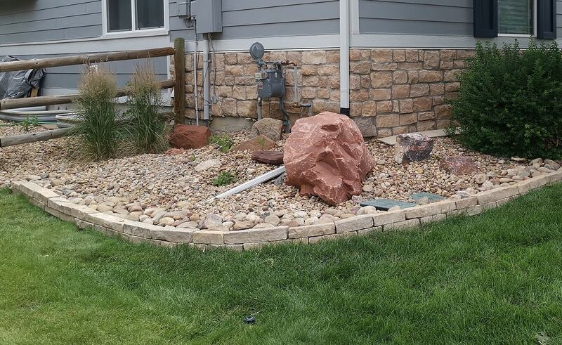 Another decorative rock border along the grass
